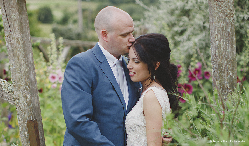 The newlyweds enjoy the gardens at this wedding venue in Sussex