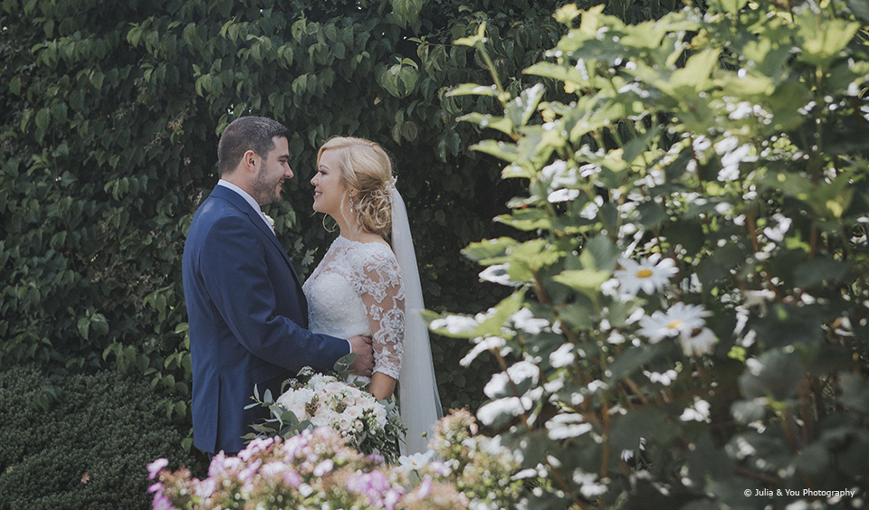 Newlyweds enjoy the gardens at Upwaltham Barns wedding venue in Sussex