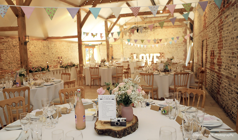 The South Barn is decorated with wedding bunting for this rustic wedding at Upwaltham Barns