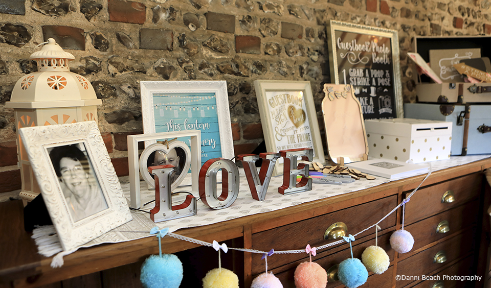 The couple used simple wedding decorations to put their own stamp on this Sussex venue