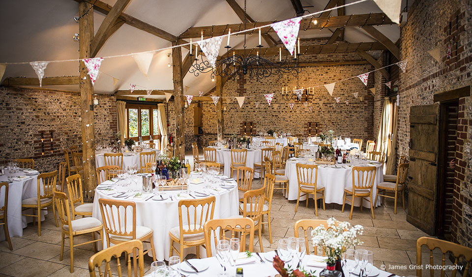 The South Barn is set up for a country wedding at Upwaltham Barns in Sussex