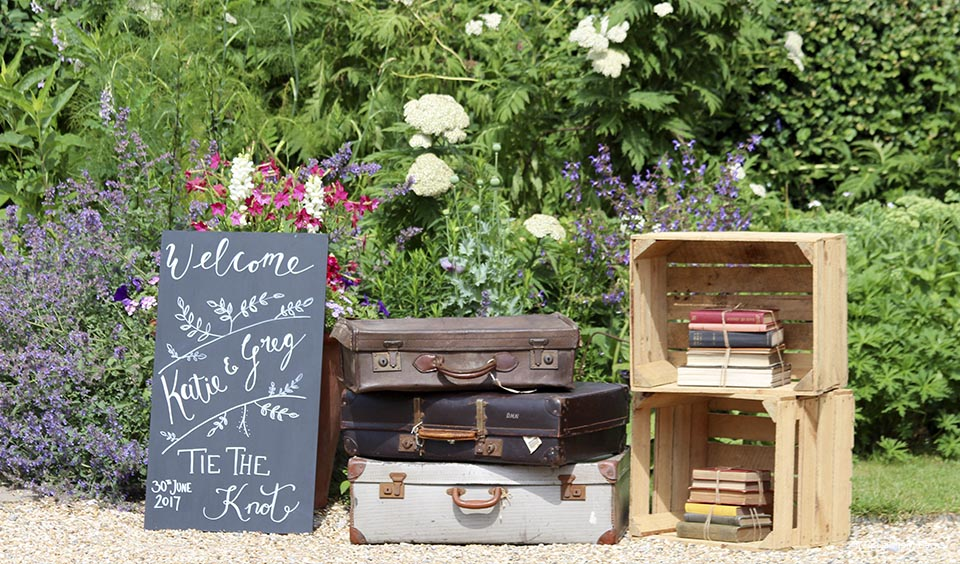 Apple crates and suitcases make for great props for a rustic wedding at Upwaltham Barns
