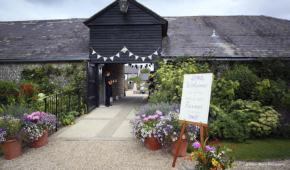 Bunting hangs above the entrance to Upwaltham Barns – wedding ideas