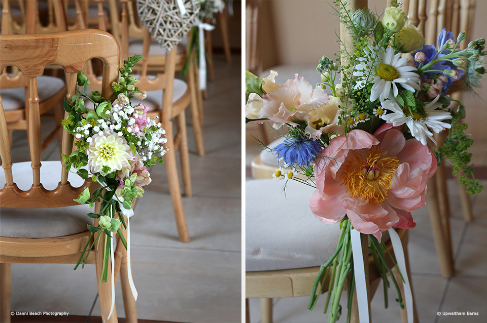 Add floral spring posies to chairs to bring colour to your wedding ceremony at Upwaltham Barns