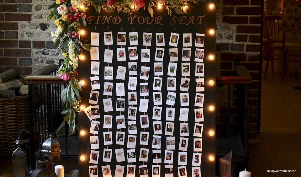 A large board with photos of each wedding guest is a fantastic personalised photo wedding table plan idea