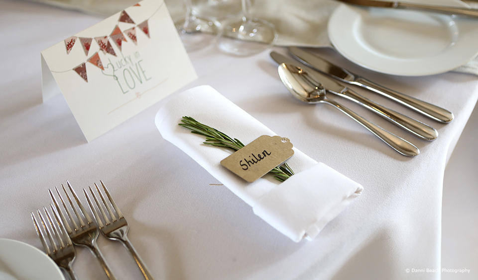 Rosemary is used to add style to a simple table place setting in the South Barn at Upwaltham Barns