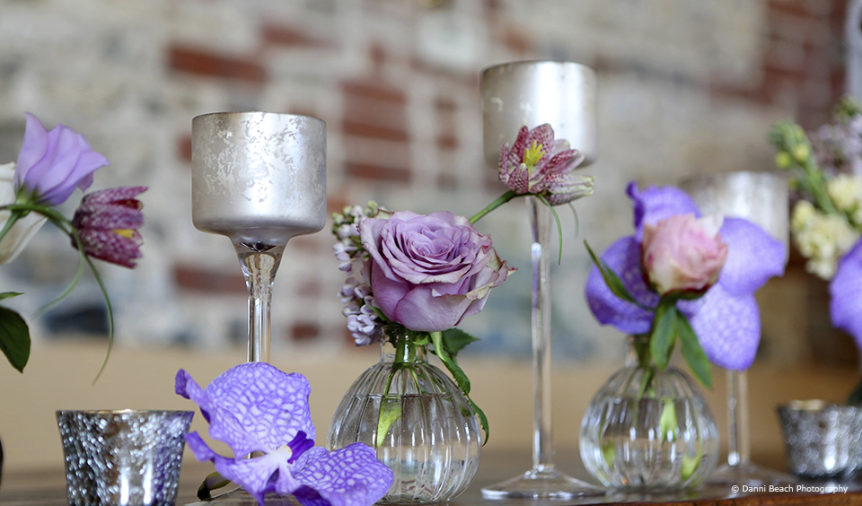 Purple flowers add a pop of colour to a spring wedding at Upwaltham Barns
