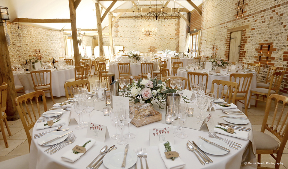 The South Barn is set for a simple wedding breakfast at Upwaltham Barns