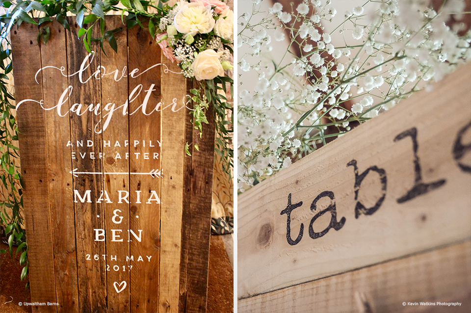 A handmade wooden wedding sign add a personal touch to a wedding at Upwaltham Barns