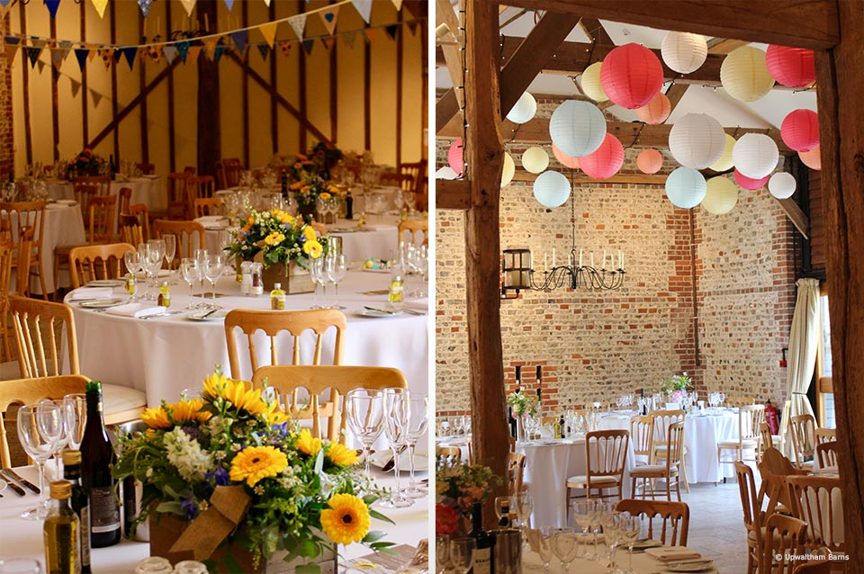 Yellow flowers are used within table centrepieces for a colourful wedding at Upwaltham Barns