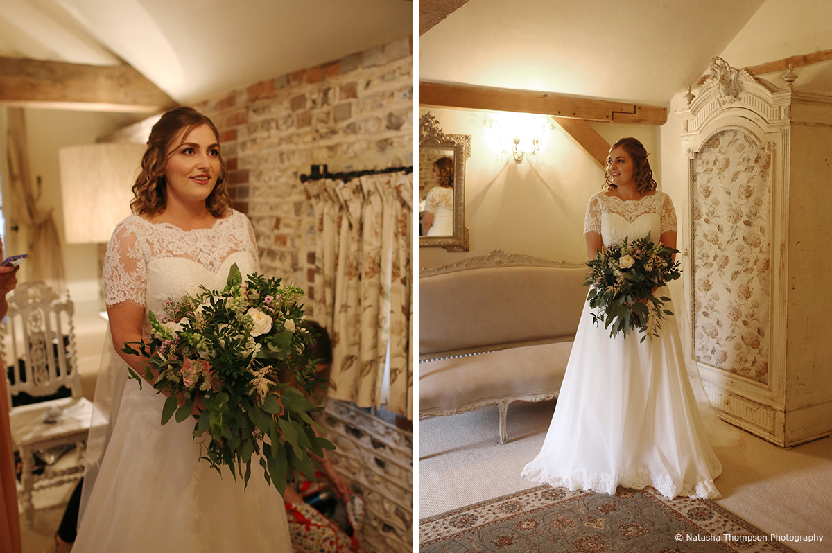 The bride wore a lace wedding dress for her winter wedding at Upwaltham Barns