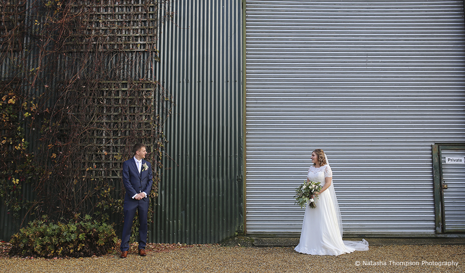 The bride and groom take a moment away from guests on their winter wedding day at Upwaltham Barns