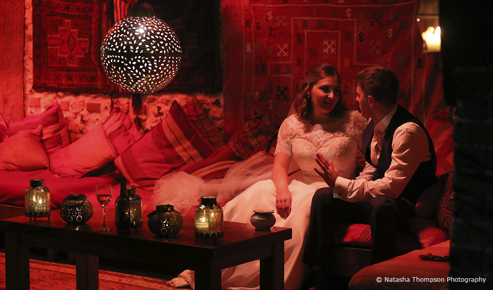 Newlyweds enjoy the Moroccan snug at Upwaltham Barns on their winter wedding day