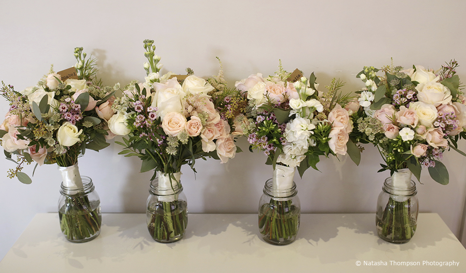 Pink and white wedding bouquets are ready for this winter wedding at Upwaltham Barns