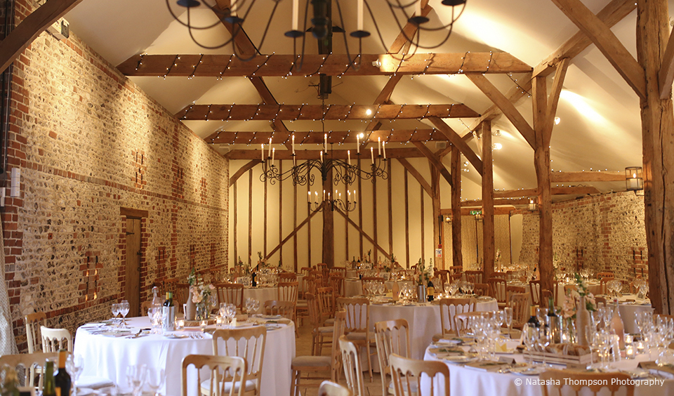 The South Barn at Upwaltham Barns is set up for a winter wedding breakfast