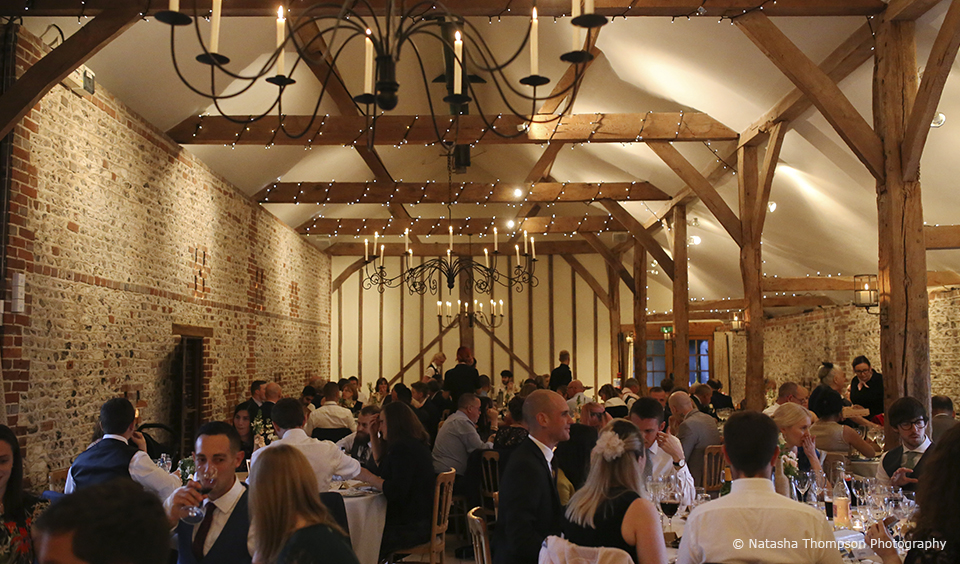 Wedding guests enjoy the wedding breakfast during a winter wedding at Upwaltham Barns