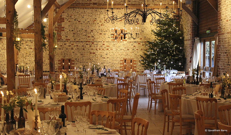 The South Barn is decorated for a festive Christmas wedding at Upwaltham Barns