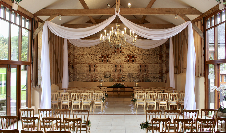 The East Barn at Upwaltham Barns is set up for an autumn wedding ceremony
