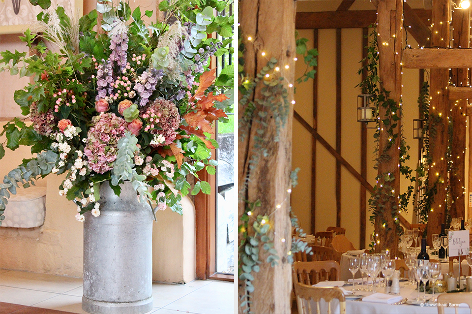Fairylights are used to decorate the beams in the South Barn at Upwaltham Barns for an autumn wedding