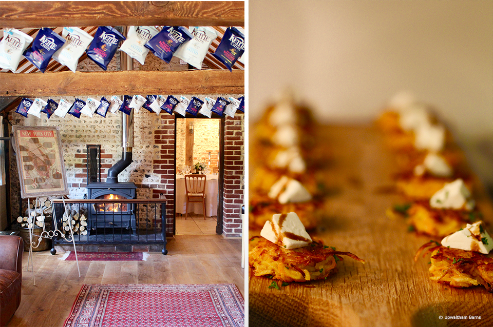 Guests can relax by the fire in the Stable Barn during an autumn wedding at Upwaltham Barns