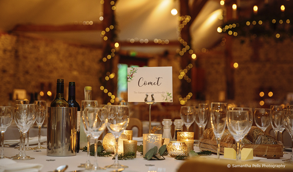 For their winter wedding at Upwaltham Barns the couple used Christmas reindeers as inspiration for their table names