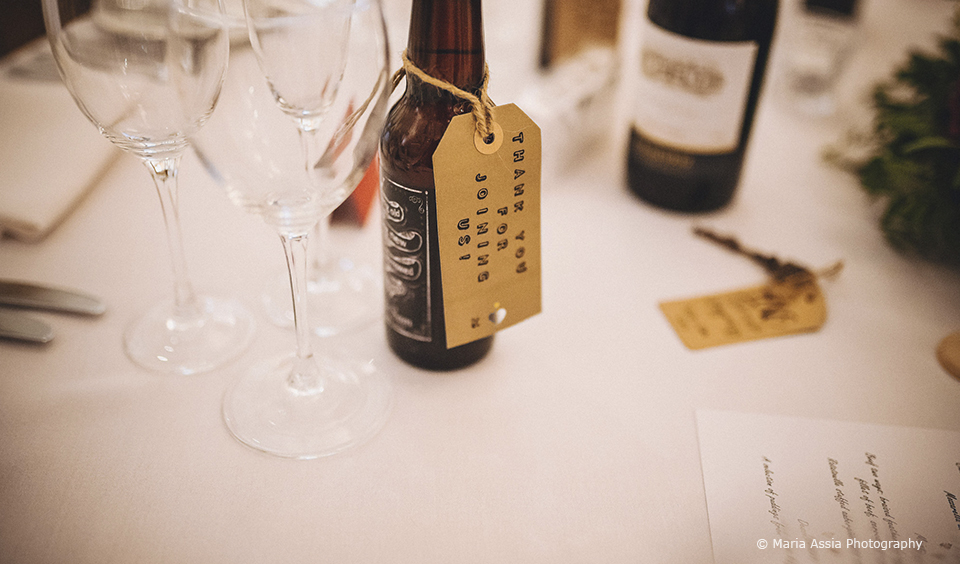 The couple gave guests bottles of beer for their festival themed wedding at Upwaltham Barns