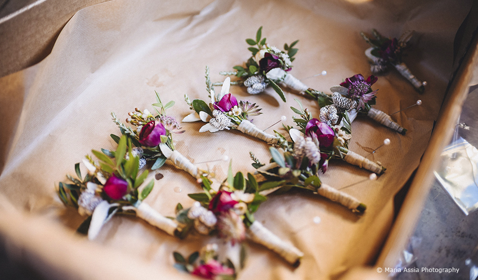 The couple chose 'garden like' button holes in greens and pinks for their wedding at Upwaltham Barns