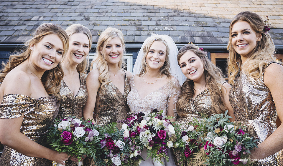 The bridal party wore gold sequinned gowns for this winter wedding at Upwaltham Barns