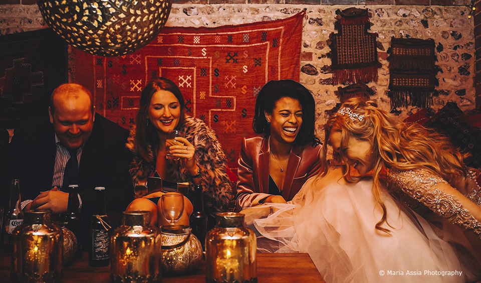 Wedding guests gather in the cosy Moroccan Snug at Upwaltham Barns