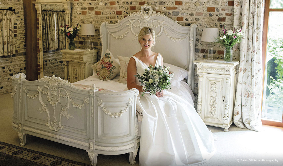 A bride prepares for her wedding ceremony at Upwaltham Barns in the Jasmine Cottage