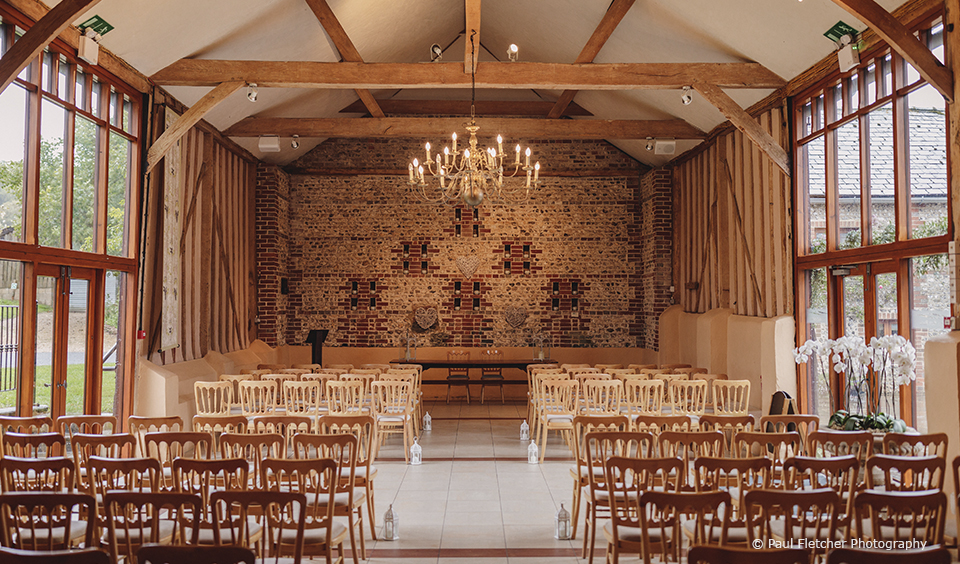 The East Barn at Upwaltham Barns is set up for a wedding ceremony