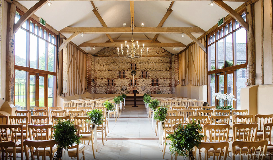 The East Barn at Upwaltham Barns wedding venue is set up for a wedding ceremony