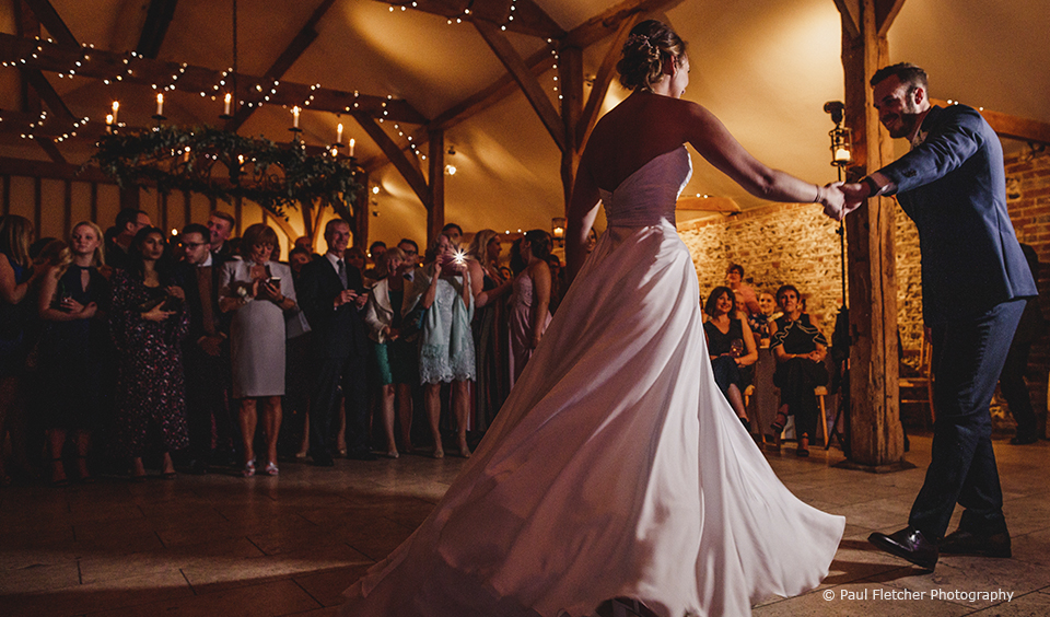 Newlyweds perform their first dance in the South Barn at Upwaltham Barns