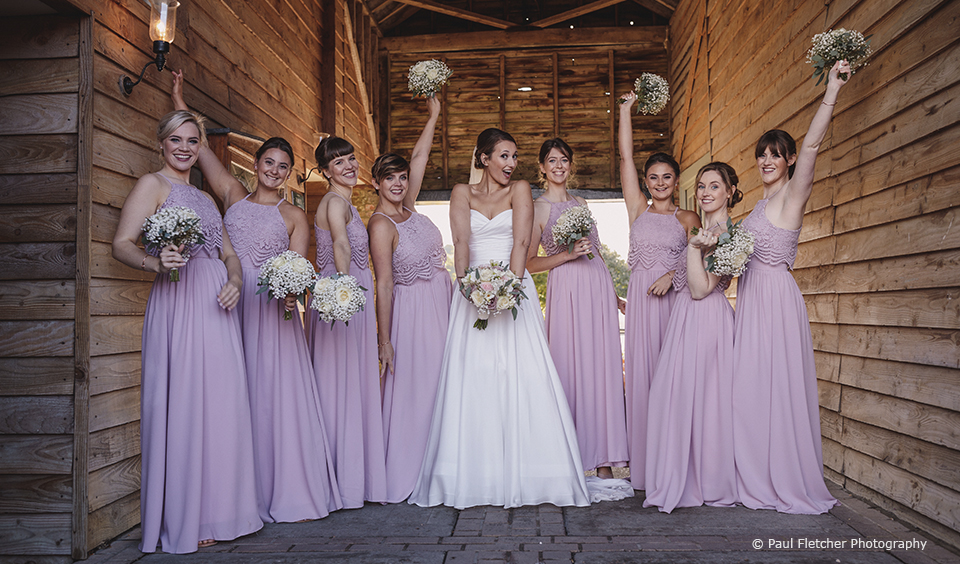 For this rustic wedding at Upwaltham Barns the bridal party wore pink bridesmaids dresses