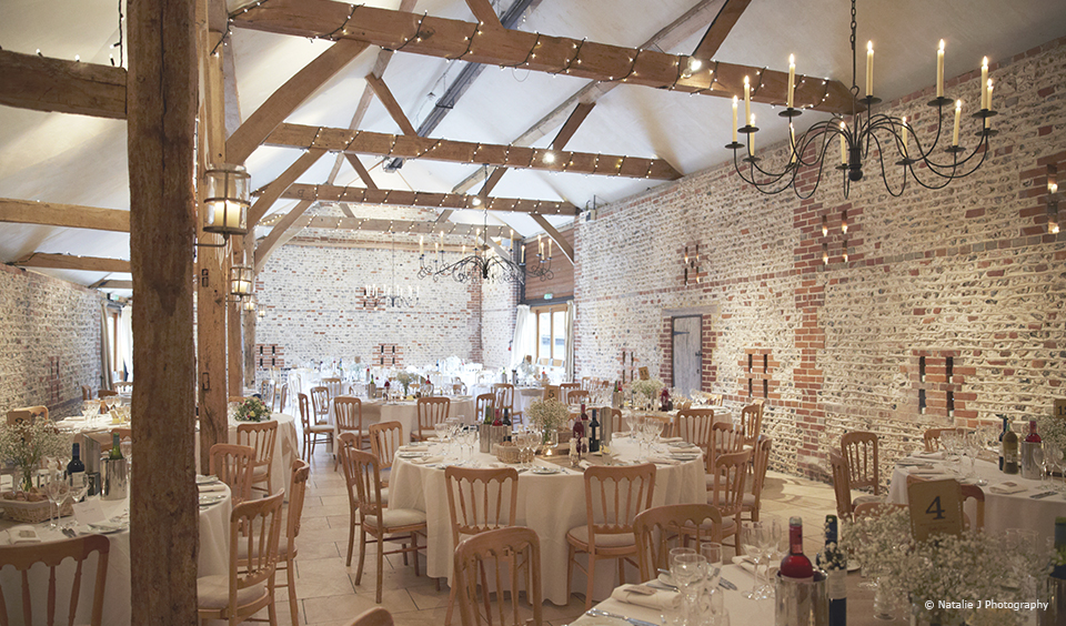 The South Barn at Upwaltham Barns is set up for a rustic wedding reception