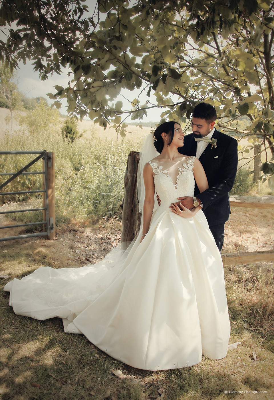 The bride and groom explore the countryside that surrounds Upwaltham Barns on their wedding day