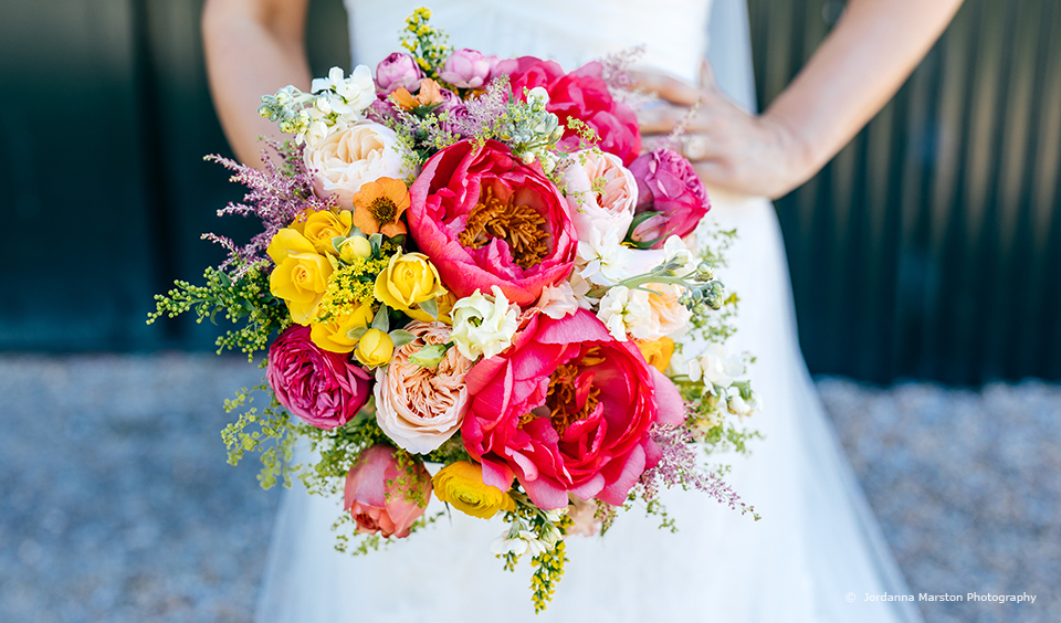 A large bright wedding bouquet is perfect to add a splash of colour to your wedding at Upwaltham Barns