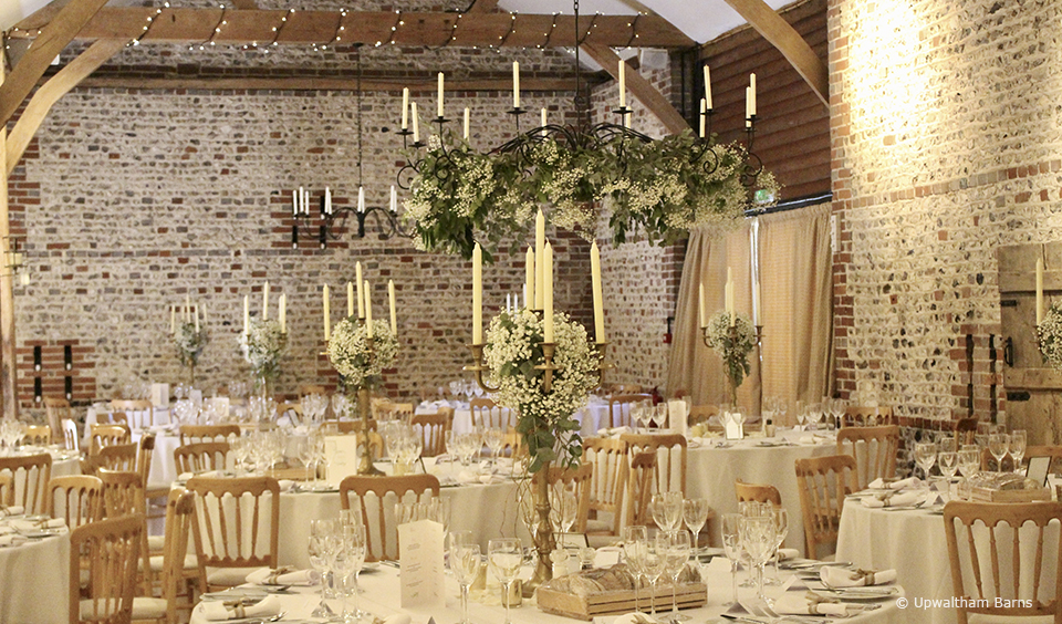 The South Barn at Upwaltham Barns is dressed for an elegant wedding breakfast