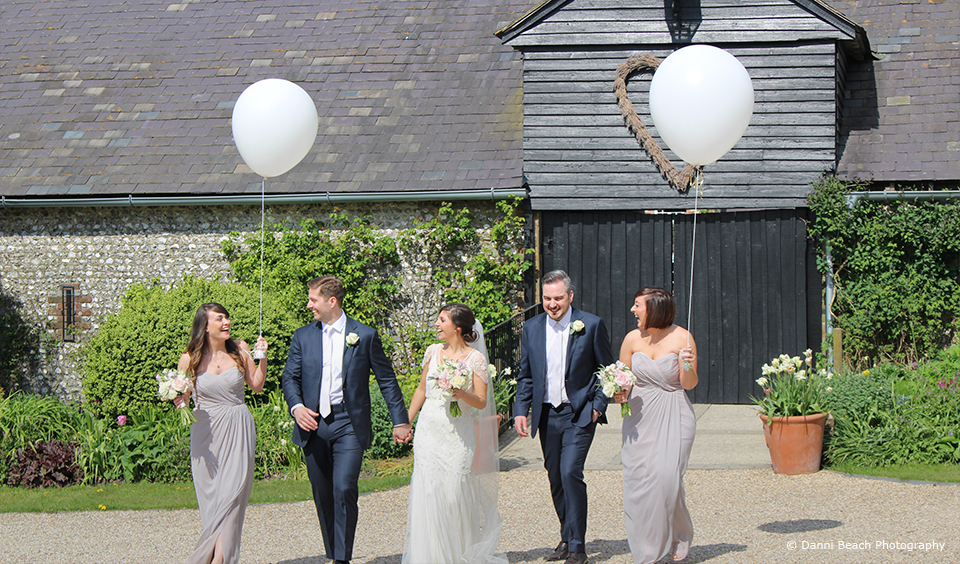 The wedding party enjoy exploring the grounds at Upwaltham Barns wedding venue in Sussex