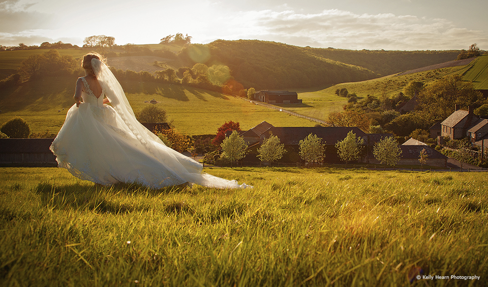 The bride makes the most of the countryside and the golden hour on her wedding day at Upwaltham Barns