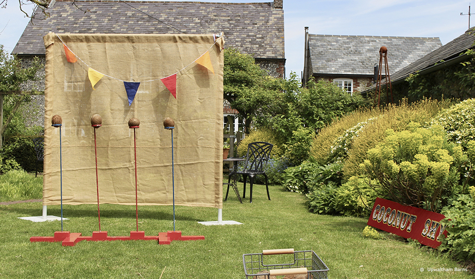 A selection of garden games are set up at Upwaltham Barns ready for a fun wedding reception