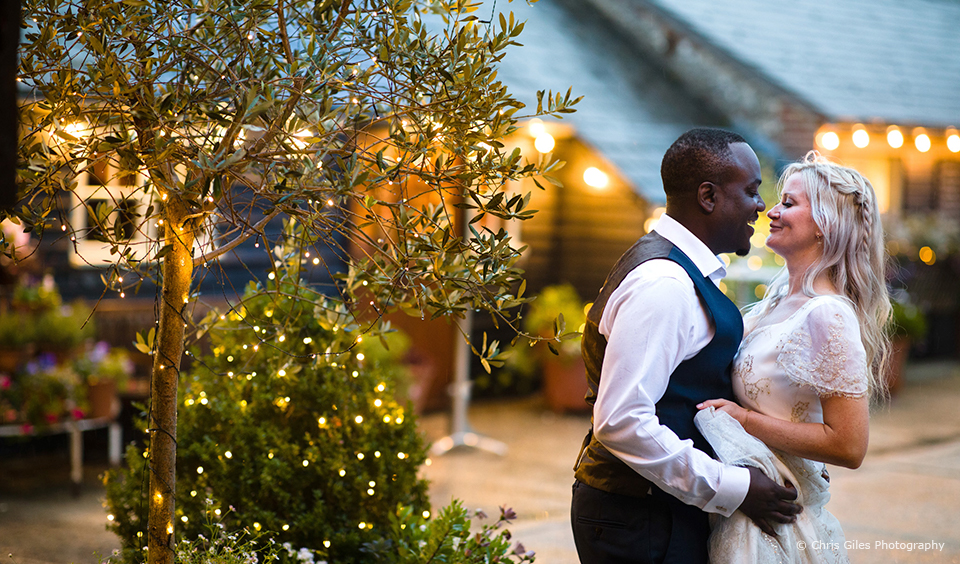 The newlyweds enjoy a moment away from guests in the courtyard at Upwaltham Barns