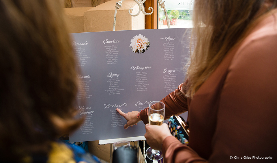 A wedding table plan shows guests to their seats in the South Barn at Upwaltham Barns