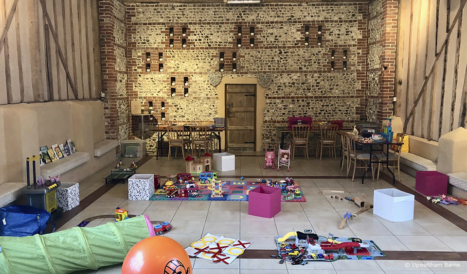 A couple created a kids creche in the East Barn at Upwaltham Barns to entertain kids during an evening wedding reception
