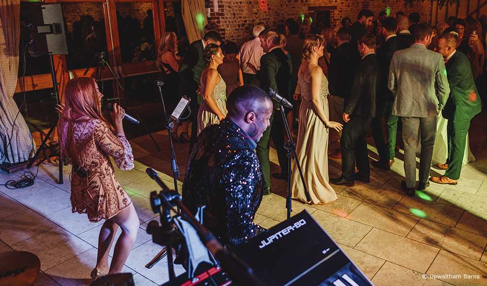 Ensure your wedding band at Upwaltham Barns play the songs you love and get your guests up and dancing