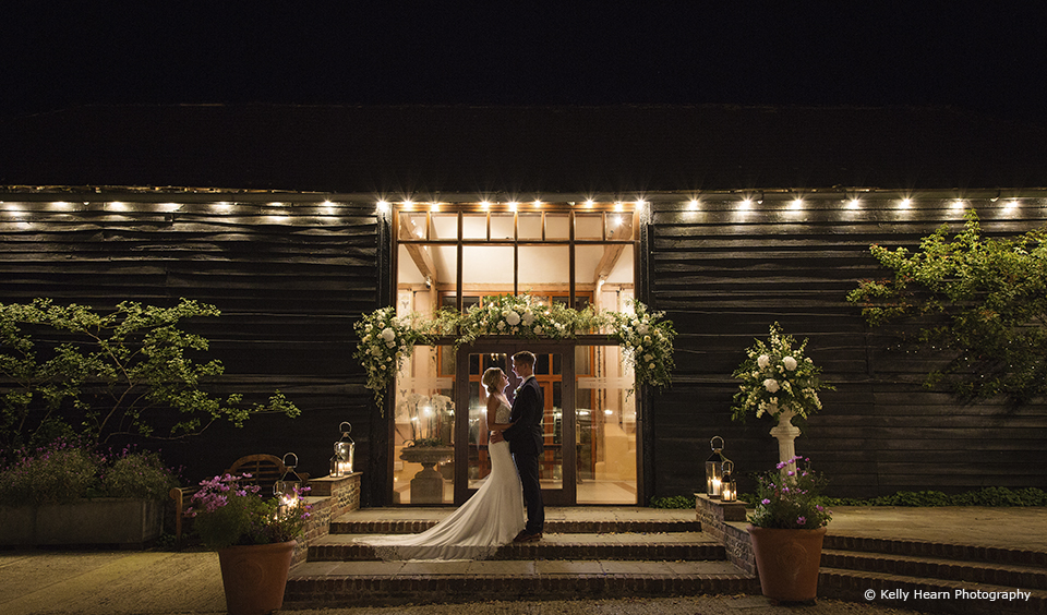 The bride and groom take a moment away from guests at their evening reception at Upwaltham Barns