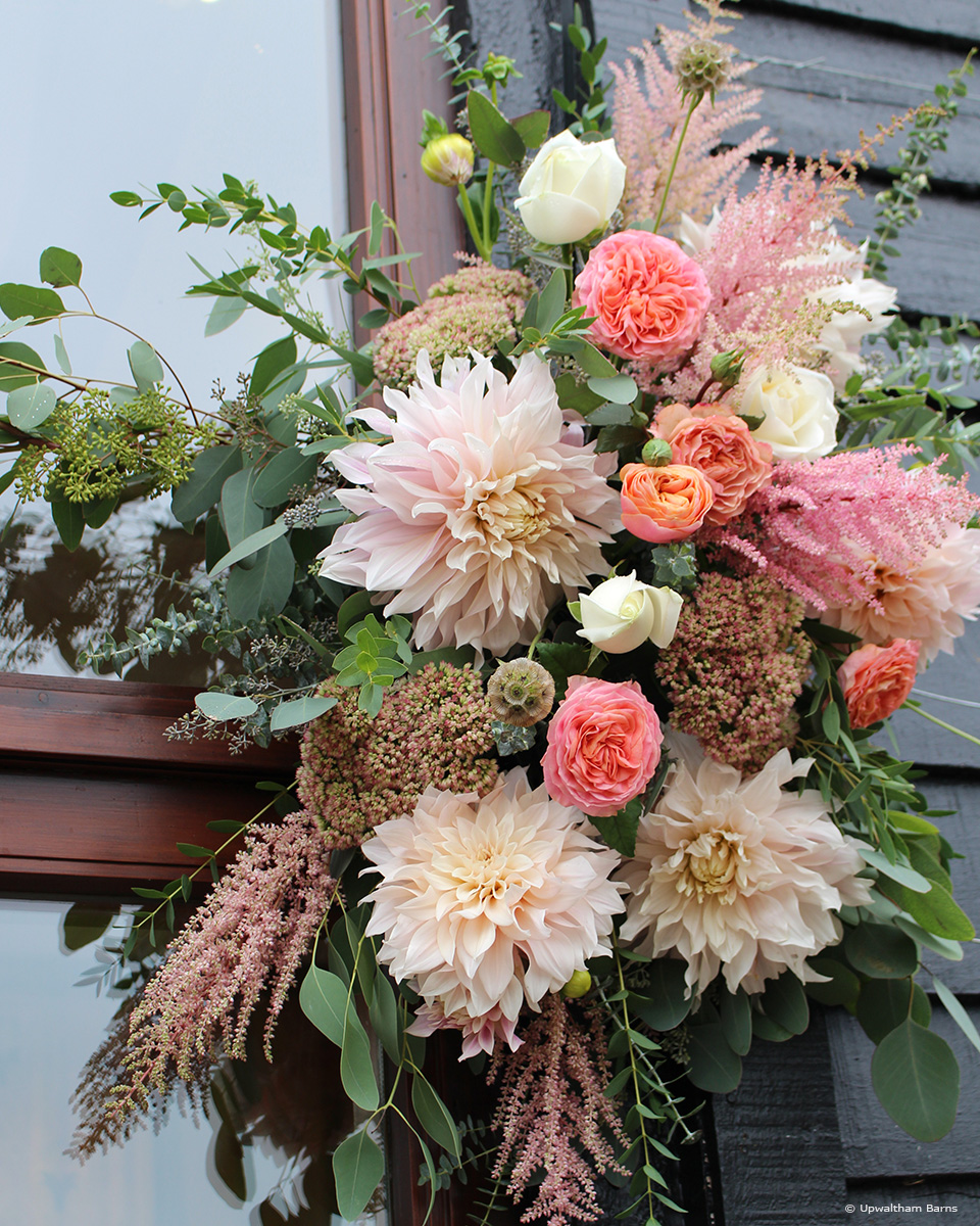 Bring in living coral the Pantone colour of the year at Upwaltham Barns via your wedding flowers