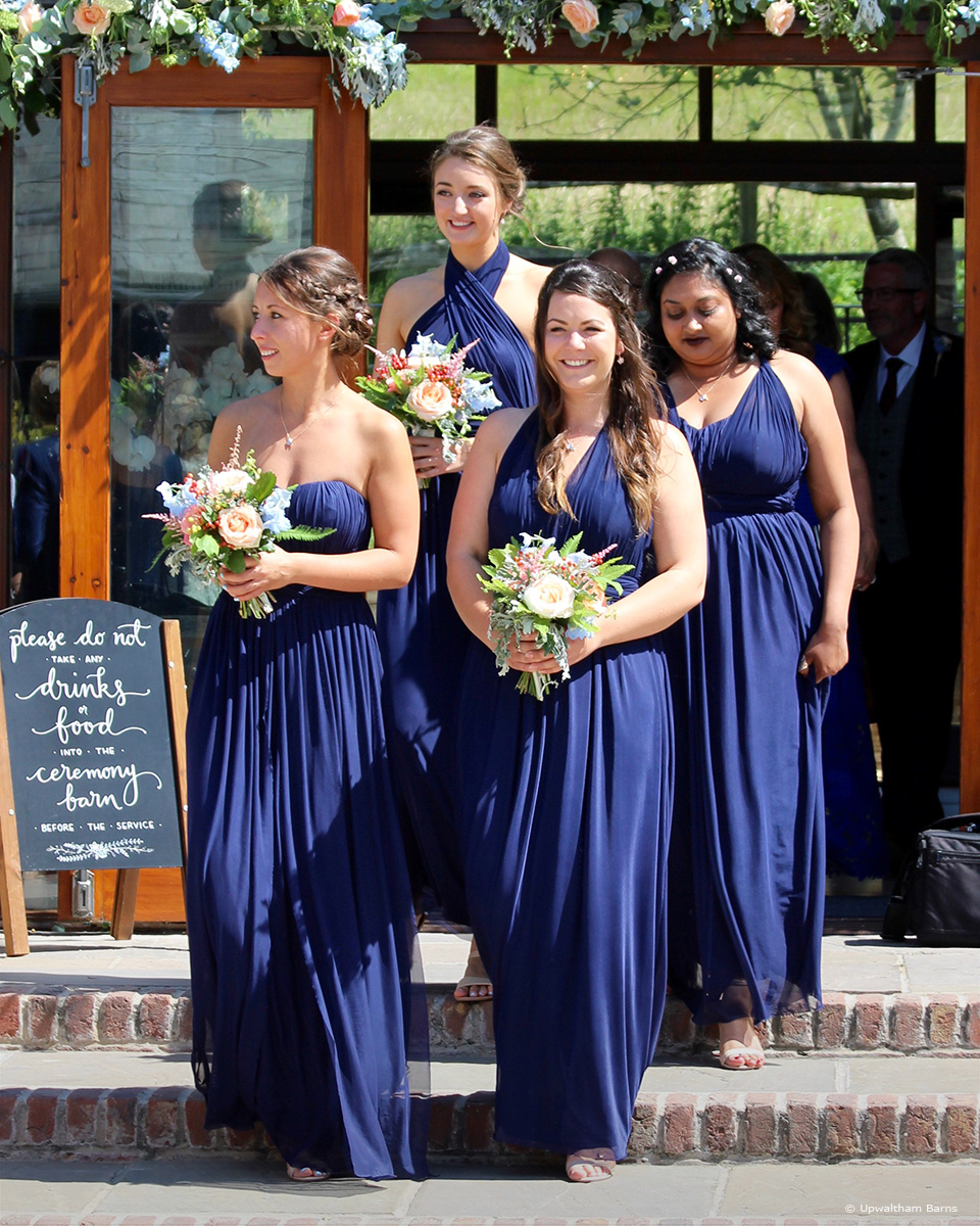 Bridesmaids at Upwaltham Barns wear navy bridesmaid dresses for an elegant summer wedding
