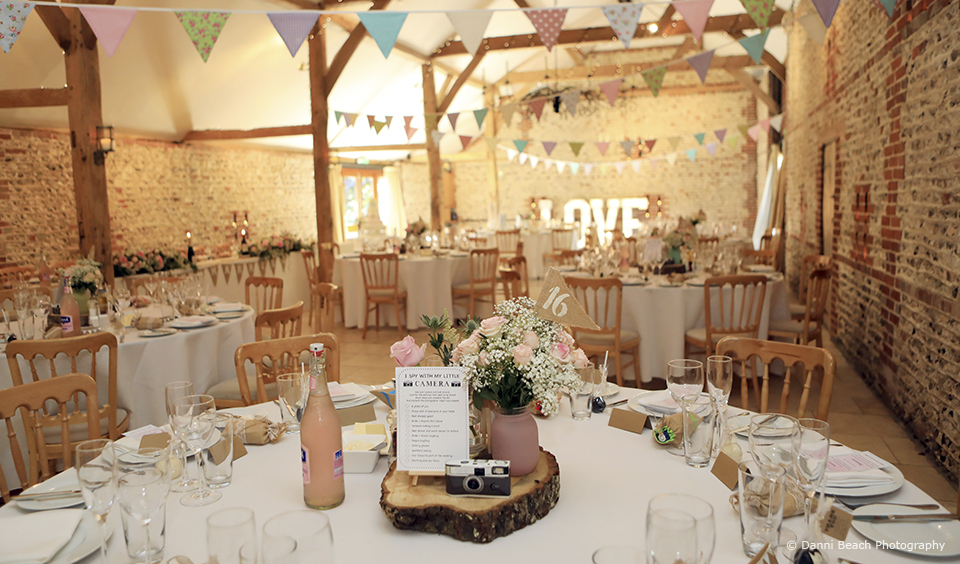 Pastel shades are the perfect for a country summer wedding reception in the South Barn at Upwaltham Barns
