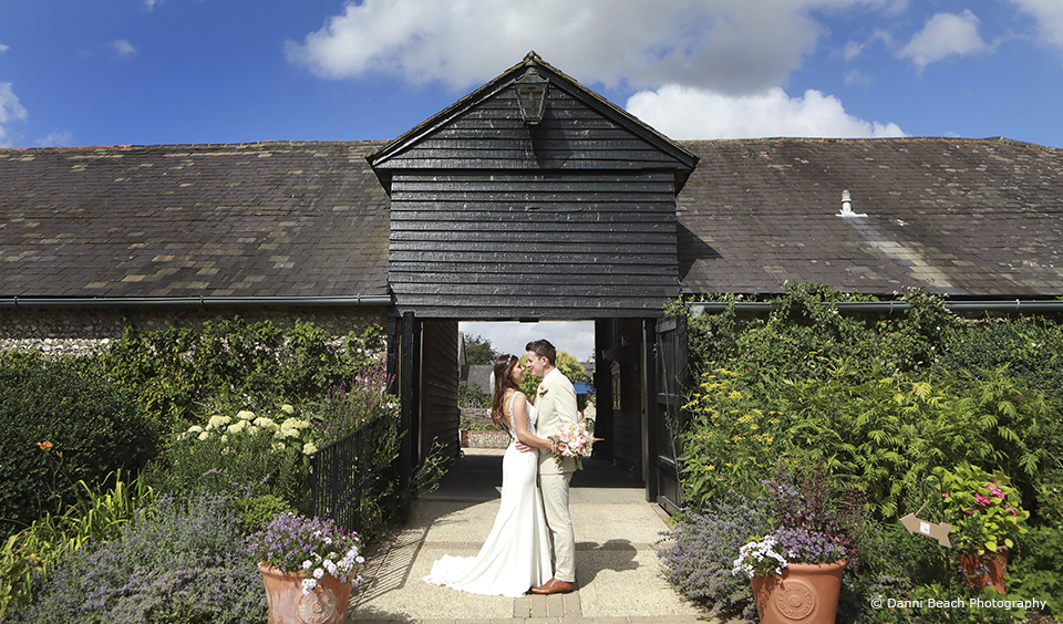The bride and groom enjoy their summer wedding day at Upwaltham Barns